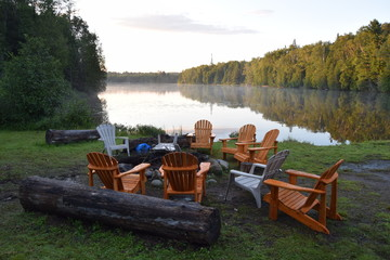 Cottage Lakeside at dawn with chairs