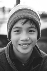 Portrait of young, smiling boy looking at the camera and wearing winter clothes