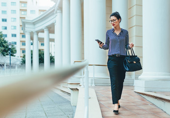 Business professional using smart phone in the city