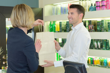 woman buying in store cosmetics