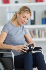 female photographer on wheelchair