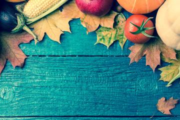 Toned image of autumn leaves, pumpkin, tomato, pomegranate,