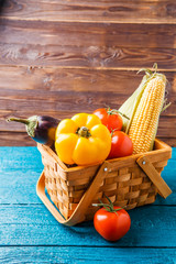 Photo of basket with autumn vegetables