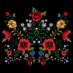 Embroidery traditional pattern with red poppies and roses.