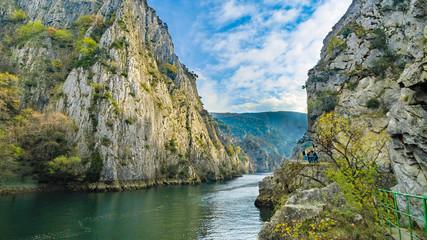 Fototapeta Famous Artificial lake Matka in Skopje, Macedonia with rocky mountains against blue sky obraz