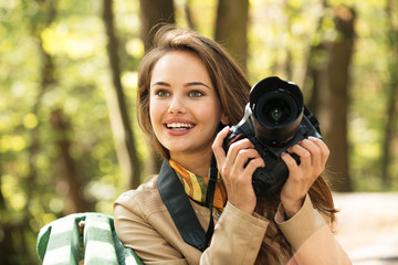 woman is a professional photographer with photo camera