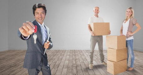people moving boxes into new home with key