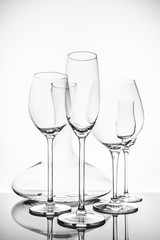 Glassware selection with wine, champagne, liquour glasses and decanter on the light background