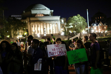 People take part in a protest inside Columbia University against former leader of the English Defence League, Robinson, and against white supremacists in New York