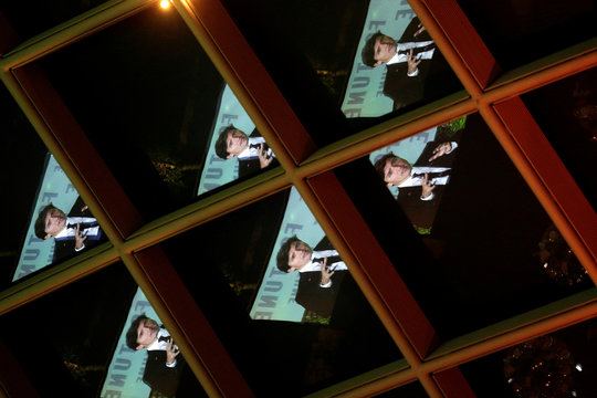 """Canadian Prime Minister Justin Trudeau is shown reflected in windows as he speaks at the 2017 Fortune magazine's """"Most Powerful Women"""" summit in Washington"""