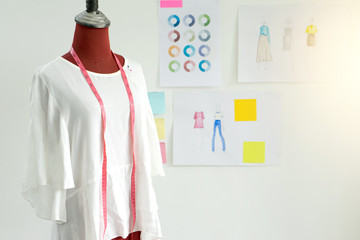 fashion designer work in the studio with graphic and tailor tool