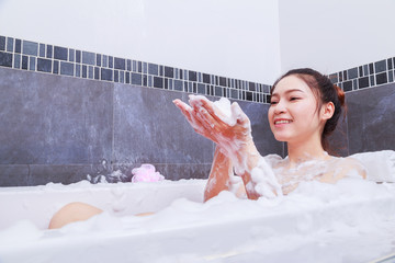 woman relaxing in the bathtub in the bathroom
