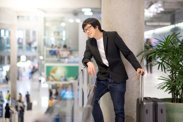 Young asian man waiting in airport terminal