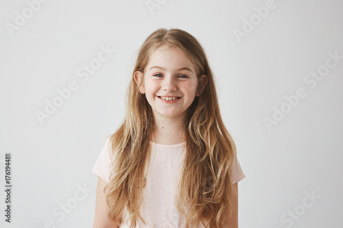 Close Up Of Funny Little Girl With Blue Eyes And Blonde Hair