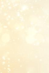 Abstract golden bokeh background. Christmas lights. Festive defocused boke. Merry Christmas card.