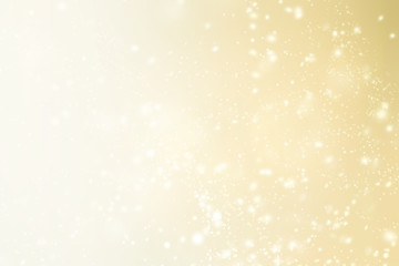 Elegant Christmas background with sparkling bokeh, snowflakes and copy place for text. Abstract golden boke background.