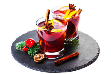 Christmas Hot mulled wine for winter with spices isolated on white background, traditional drink on winter holidays, closeup.  board with Christmas Decorations
