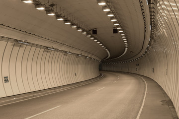 Bend in a road tunnel without traffic