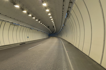 Poster Tunnel Bend in a road tunnel without traffic