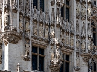 Statues on the facade of the Brussels Town Hall  in Belgium
