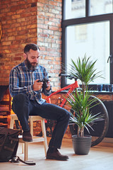 The full body image of a bearded hipster amateur photographer.