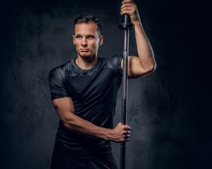 Handsome athletic man on black background