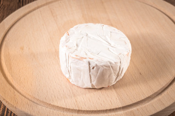 Cheese Camembert on a wooden board