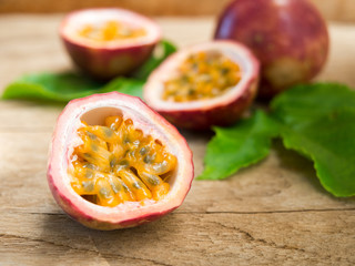 Fresh passion fruit cut in half.