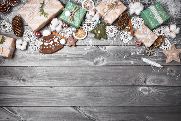 Frame from the Christmas decorations on an old wooden table. Holidays Christmas background. Space for text or design. Top view.