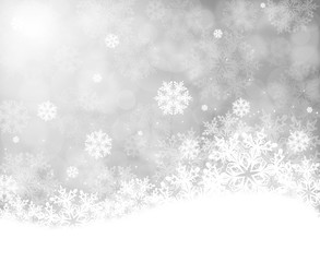 Christmas background with snowflakes on grey bokeh