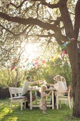 Family having meal in sunny garden