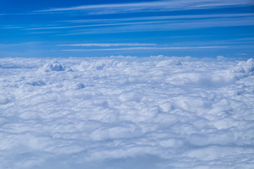 Cloud texture and blue sky view from airplane.