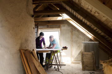 Couple making plans to renovate old attic