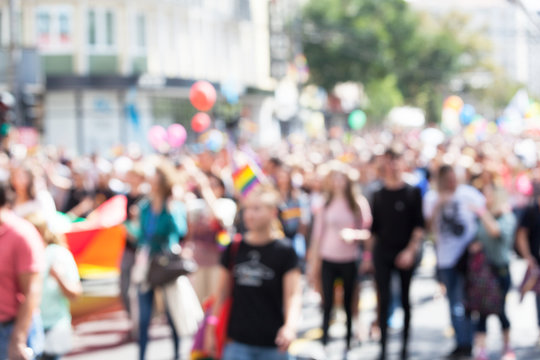 Blurred picture of participants of LGBT parade. Gay pride.