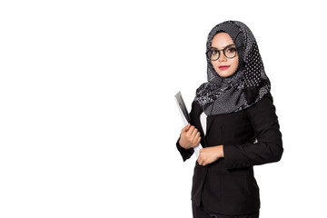 Beautiful modern Asian Muslim business woman holding reports and looking at camera,isolated on white background with clipping path.