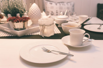 Breakfast table with white dishes