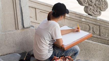 23 September, 2017 – Taipei, Taiwan, Asian girl drawing