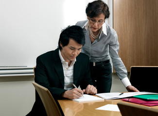 Business woman helping trainee