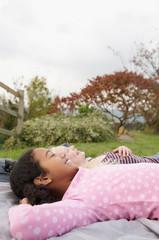 Girls resting on tent