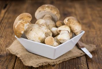 Fresh Porcinis (raw) on a vintage background (close-up shot)