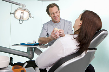 A dentist in surgery with a patient