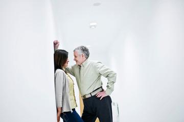 suggestive couple in corridor