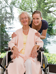 woman touching senior woman's shoulders