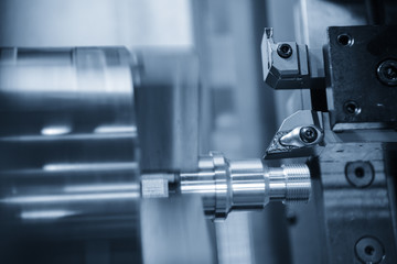 CNC lathe machine (Turning machine) cutting the metal  screw thread part by lathe cutter .Hi-precision CNC machining concept.