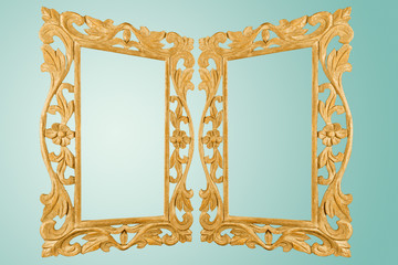 Isolated Retro Style Antique Gilt Gold Mirror Frame Handcrafted Carved Wood With Ornament Designs And Turquoise Background, Blank Space To Type Texts