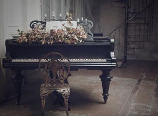 black grand piano in the interior