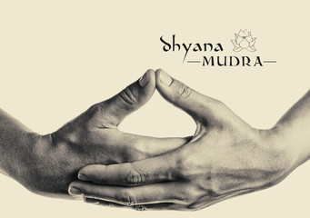 Dhyana mudra. Yogic hand gesture. Isolated on toned background black and white.