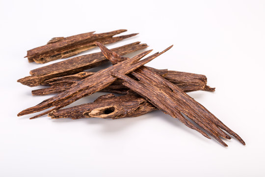Close Up Macro Shot Of Sticks Of Agar Wood Or Agarwood Isolated On White Background The Incense Chips Used By Burning It Or For Arabian Oud Oils Or Bakhoor