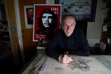 Artist Jim Fitzpatrick who has created an Irish postage stamp using the poster of Che Guevara he created in 1968 entitled 'Viva Che!' based on a photograph by Alberto Korda poses for a picture at his studio in Dublin