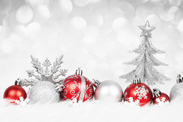 Christmas red balls with silver decoration on the snow